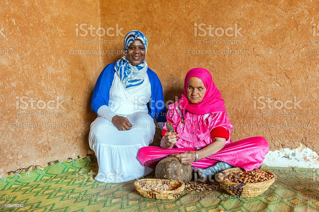 Two woman at work for manufacturing argan oil in Morocco stock photo