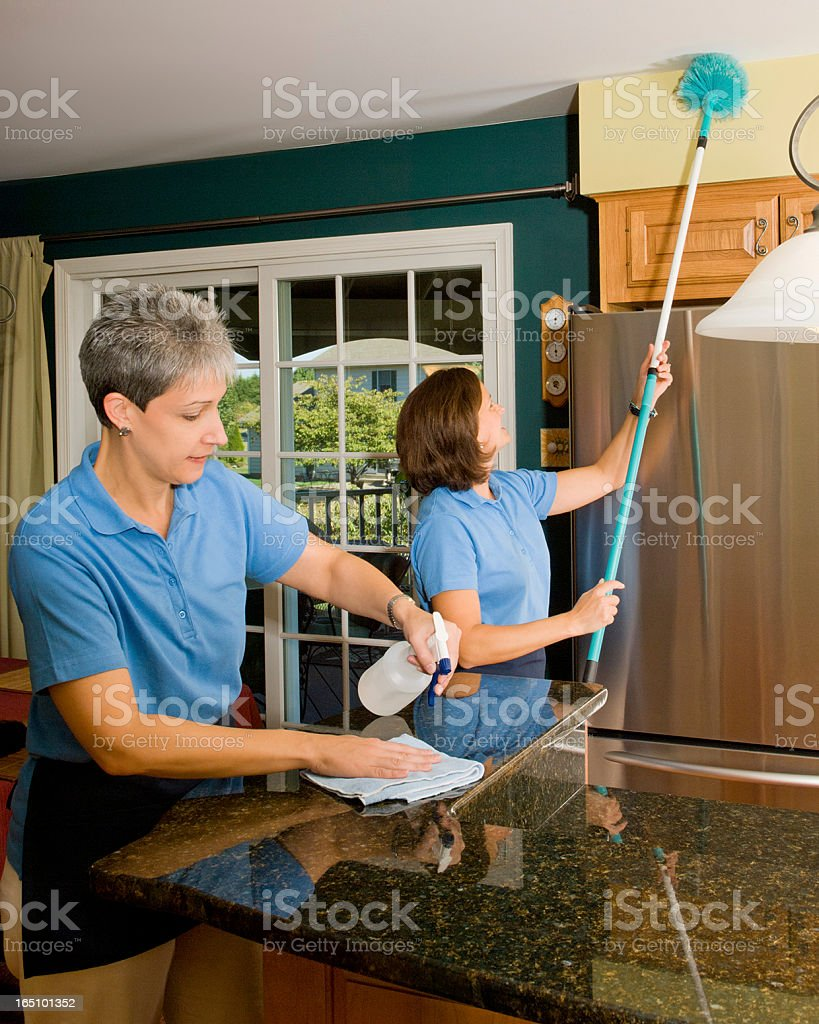 Two Woman Cleaning The Kitchen stock photo