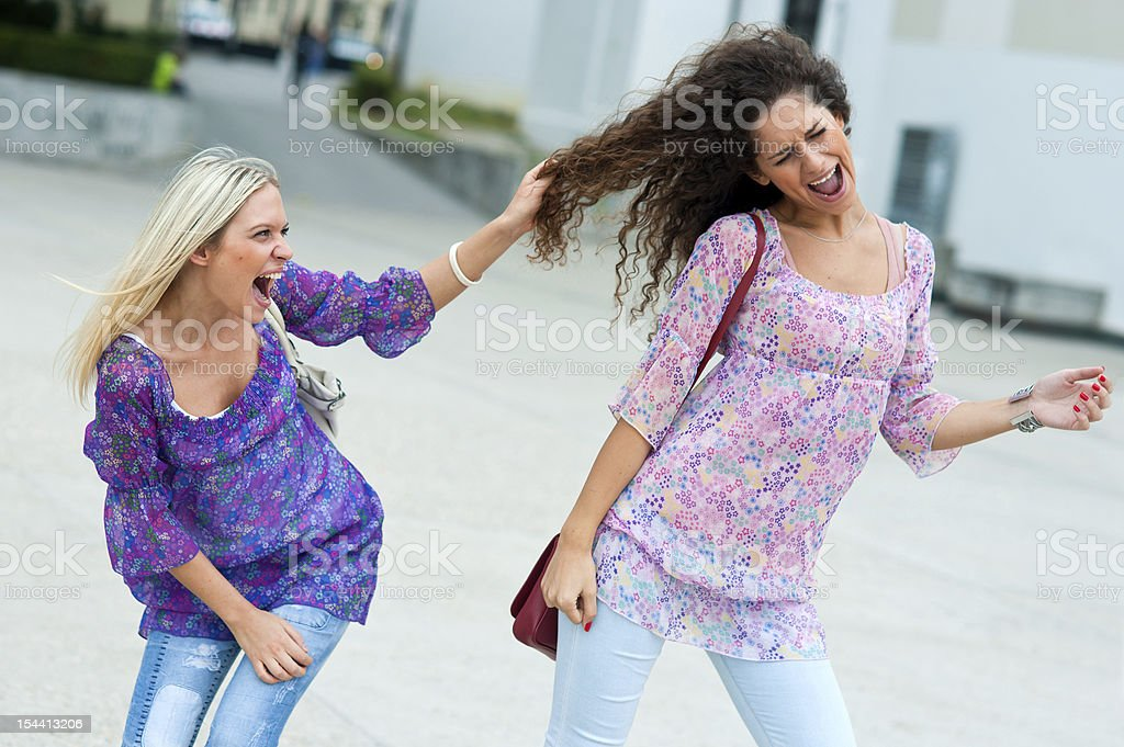 two woman fight each other royalty-free stock photo