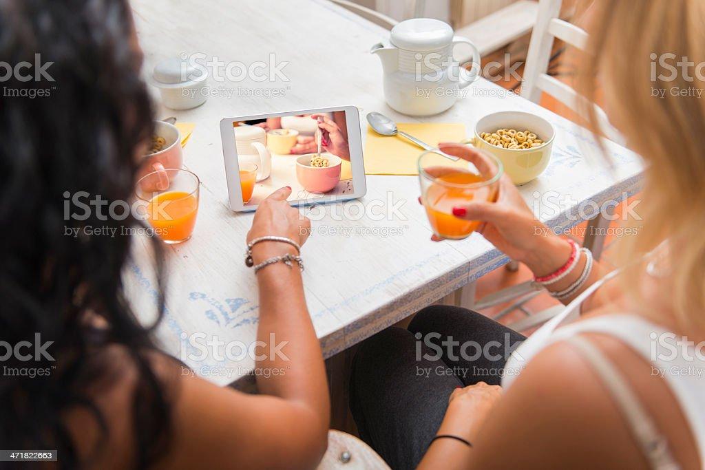 Two woman having breakfast royalty-free stock photo