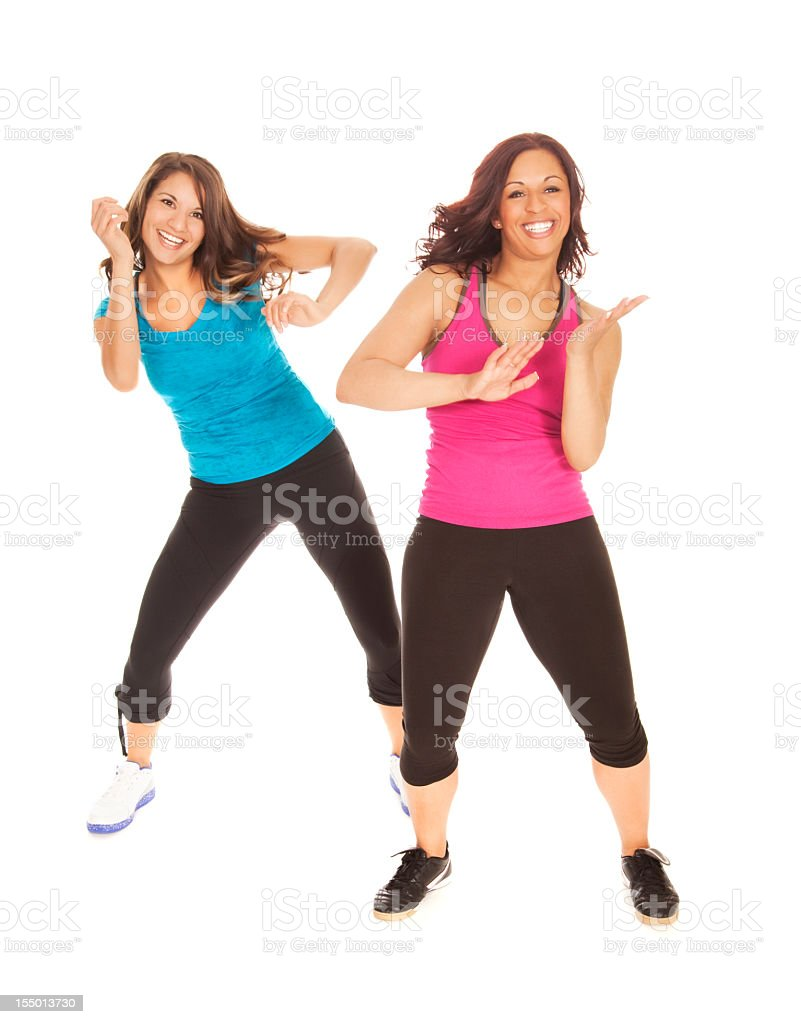 Two woman in gym clothes are dancing or doing aerobics royalty-free stock photo