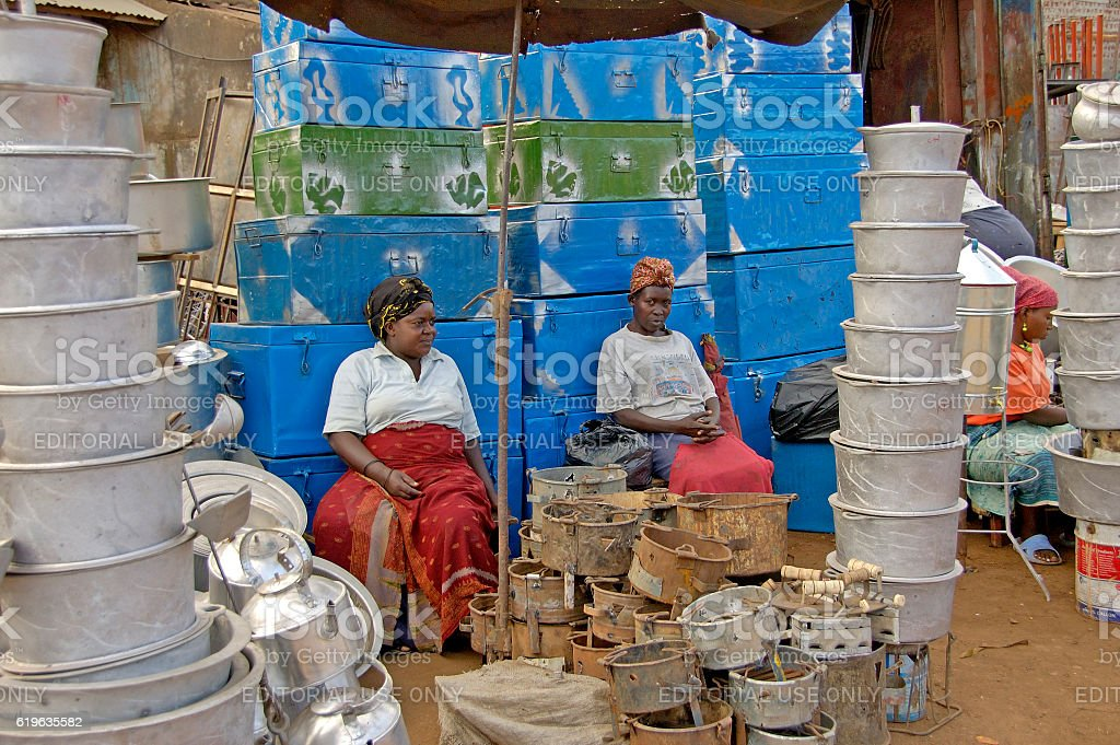 Two woman selling tin buckets and pots stock photo