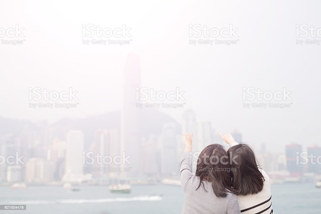 two woman show something foto stock royalty-free
