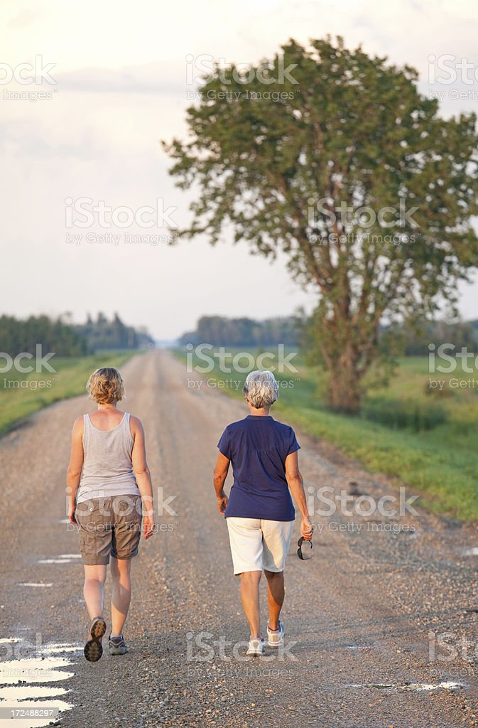 Two Woman Walking in the Country royalty-free stock photo