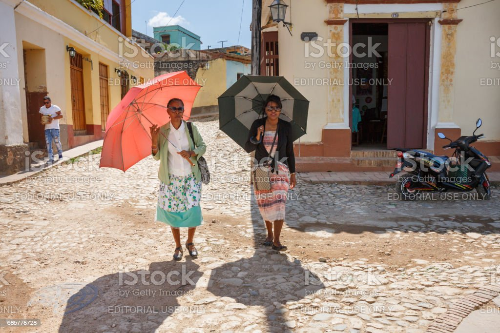 Two woman with umbrellas royalty-free stock photo