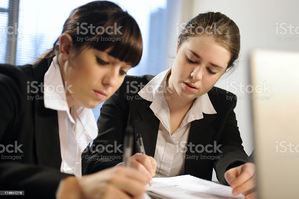 Two woman working and making notes royalty-free stock photo