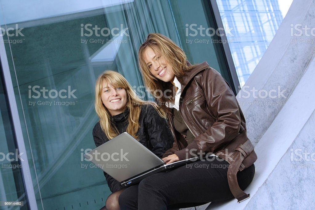 Two woman working outdoors. royalty-free stock photo