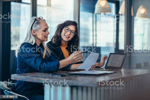 Two women analyzing documents at office picture id1018188310?b=1&k=6&m=1018188310&s=612x612&h=i14jh v as avanthxbb4bhc pncqruheujbuj53vxs=