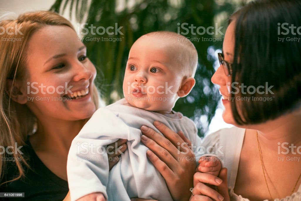 Two women and a baby stock photo