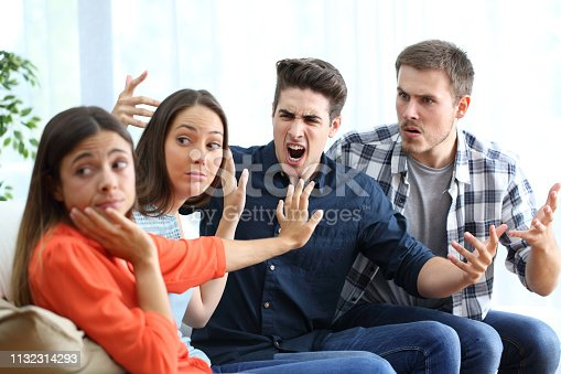 969532194 istock photo Two women and men arguing at home 1132314293