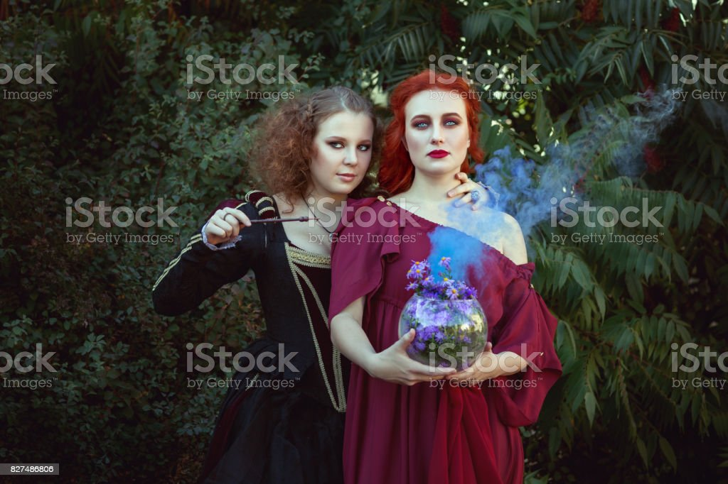 Two women are a shaman. stock photo