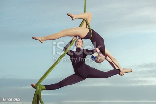 istock Two women are air gymnasts. 844061280