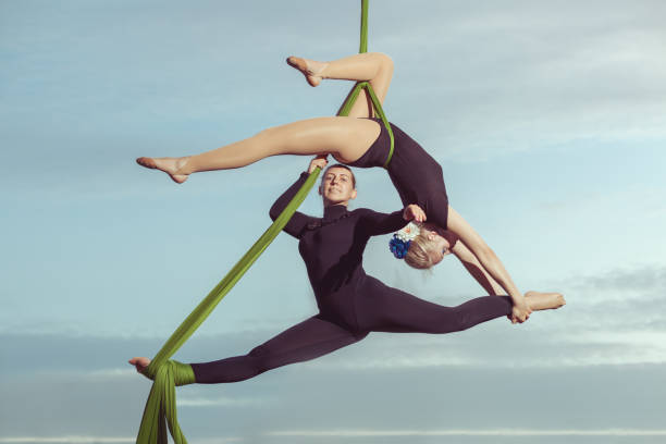 Two women are air gymnasts. stock photo