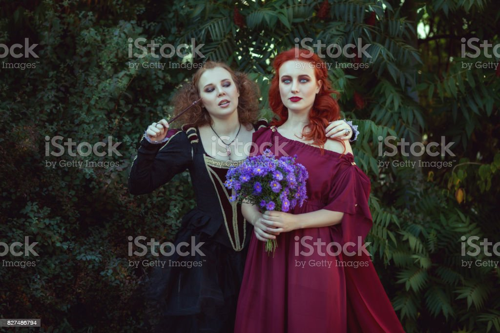 Two women are conjuring. stock photo