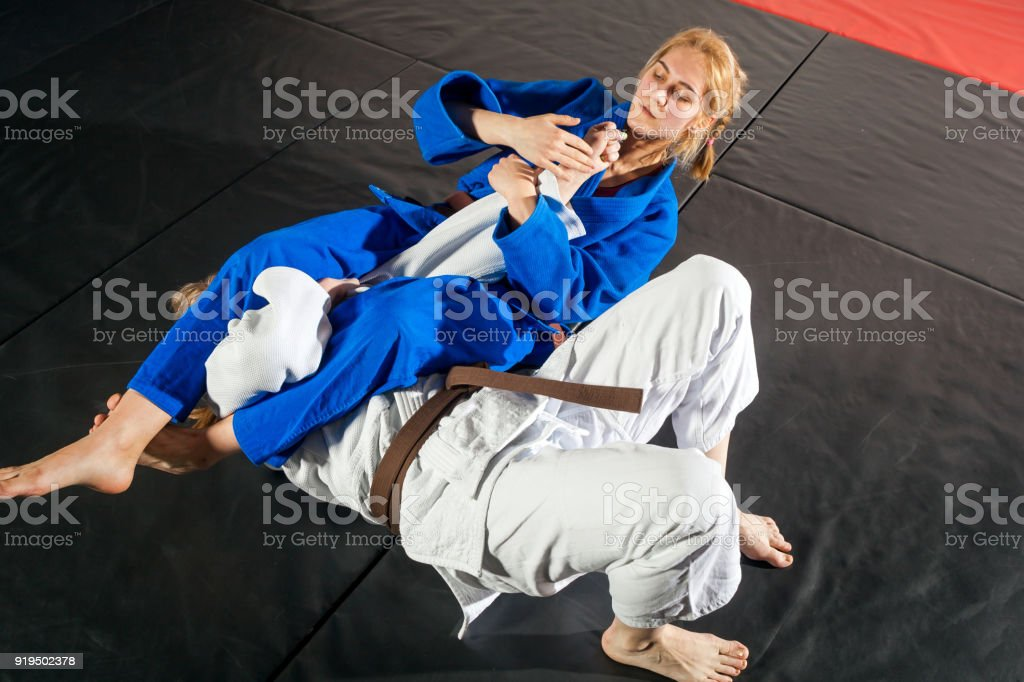 Two women are fighting on tatami stock photo