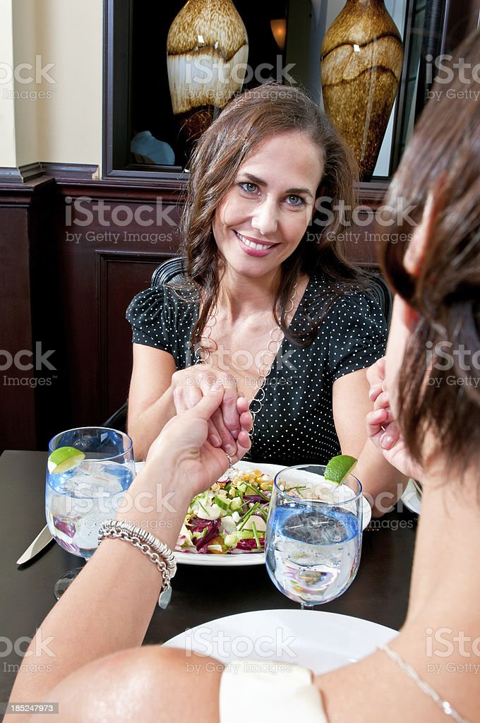 Two women are having dinner at the restaurant - VI royalty-free stock photo