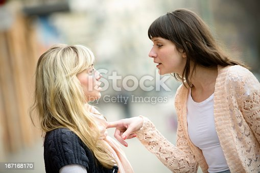 istock Two women arguing on the street 167168170