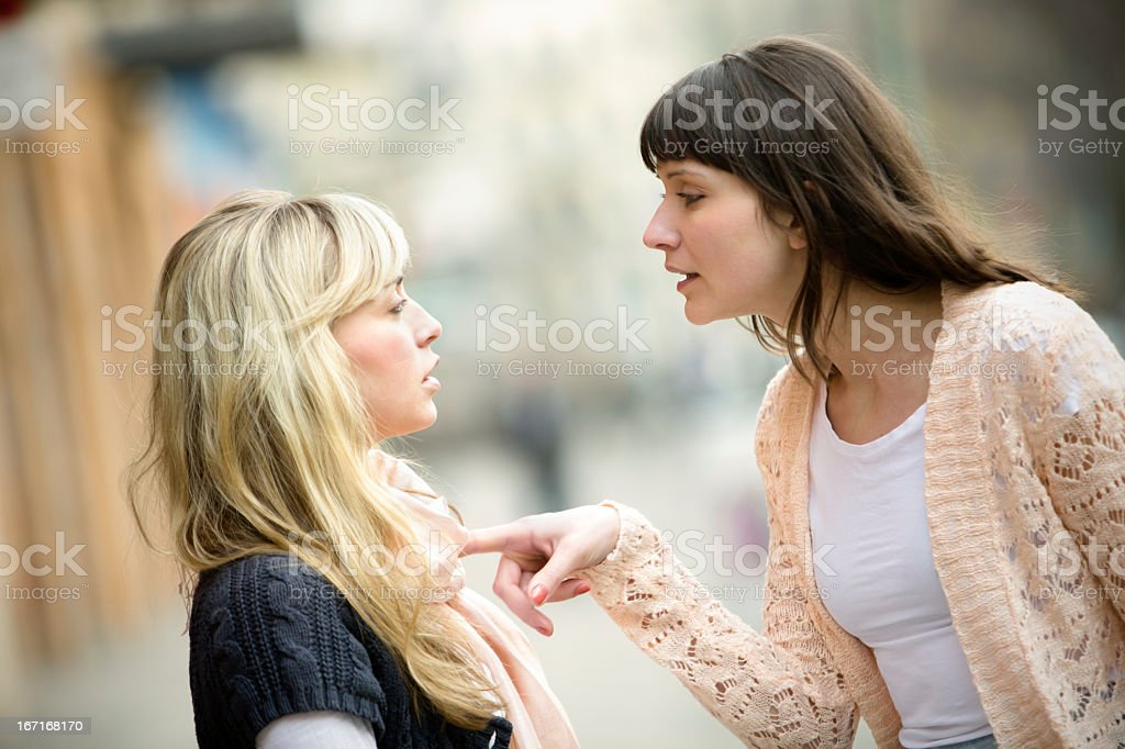 Two women arguing on the street stock photo