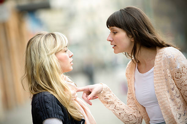 two women arguing on the street - fighting stock photos and pictures