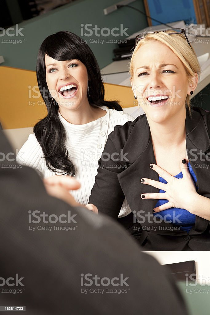 Two Women at Work Laughing With Co-Worker royalty-free stock photo
