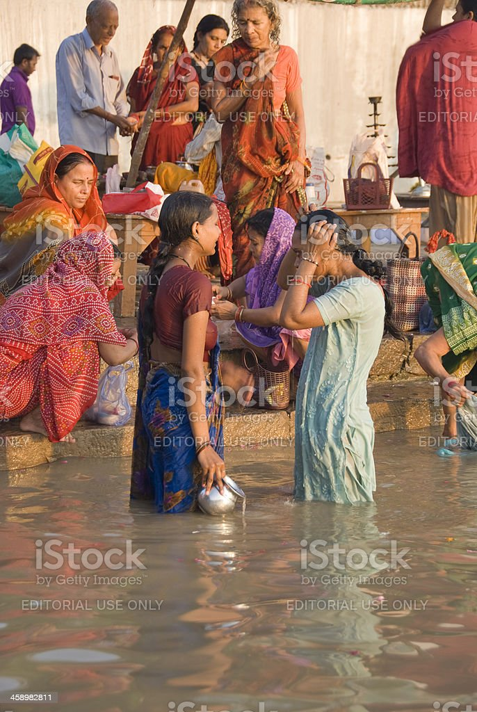 https://media.istockphoto.com/photos/two-women-bathing-in-the-river-ganges-picture-id458982811