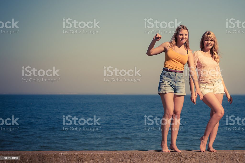 Two women best friends having fun outdoor royalty-free stock photo