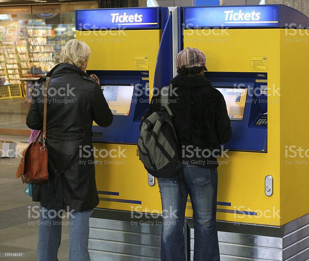 Two women buying train ticket at Dutch railway station stock photo