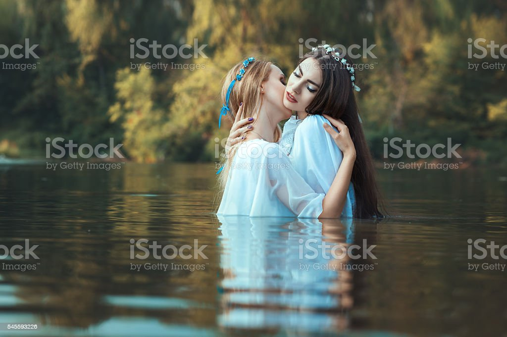 Two women caress each other. stock photo