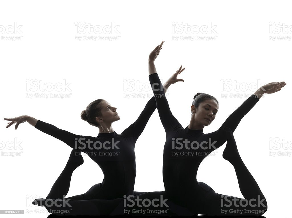 two women contortionist exercising gymnastic yoga silhouette royalty-free stock photo