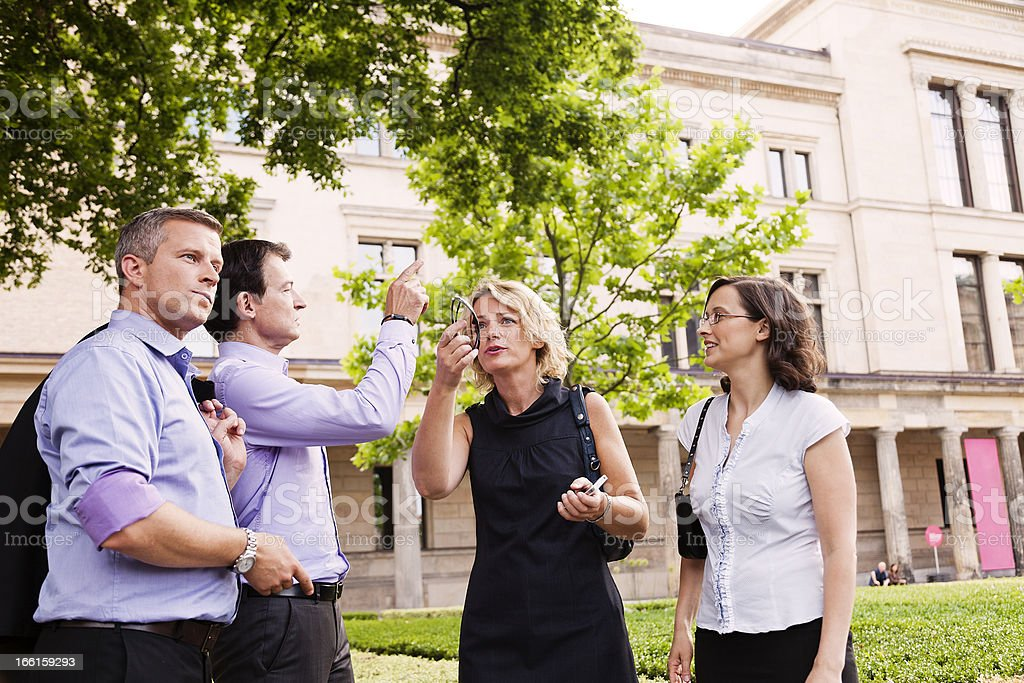 Two Women Couple of Men Discussing Direction royalty-free stock photo
