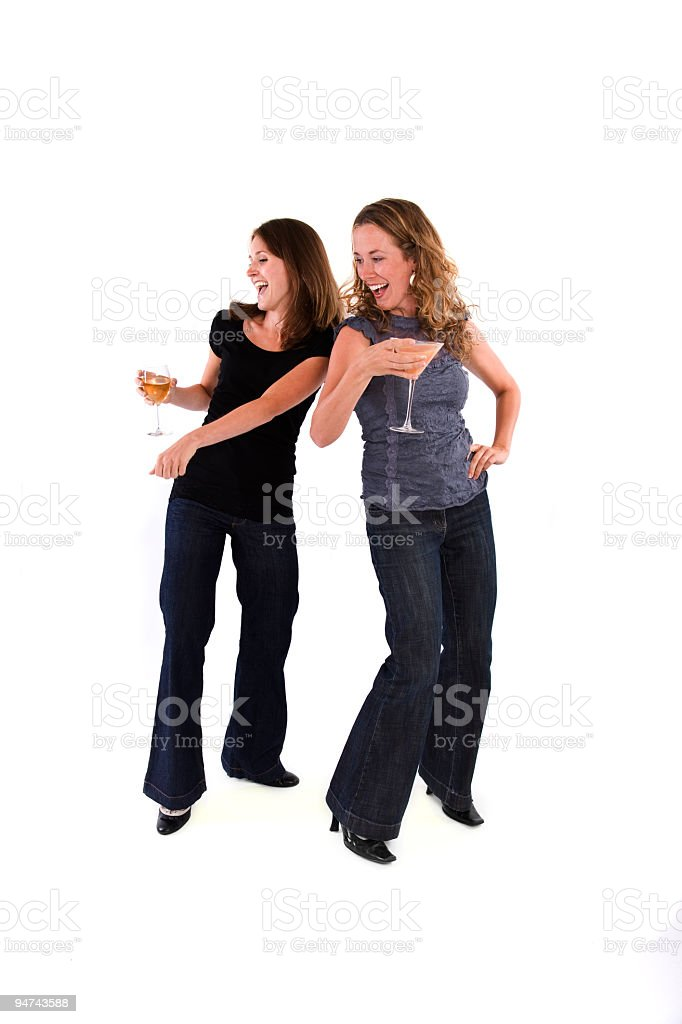 Two Women Dance, Drink and Laugh royalty-free stock photo