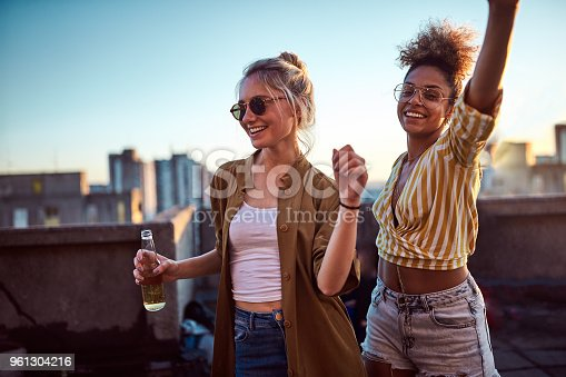 istock Two women dancing at the party. 961304216