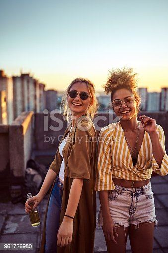 istock Two women dancing at the party. 961726980