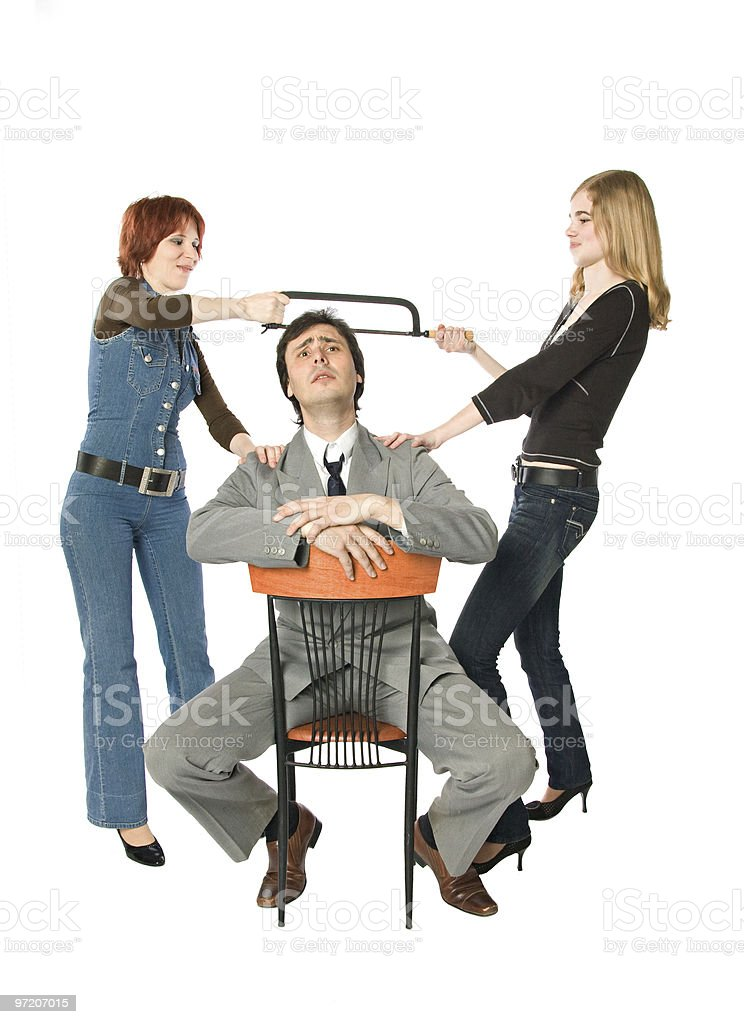Two women dividing a man stock photo