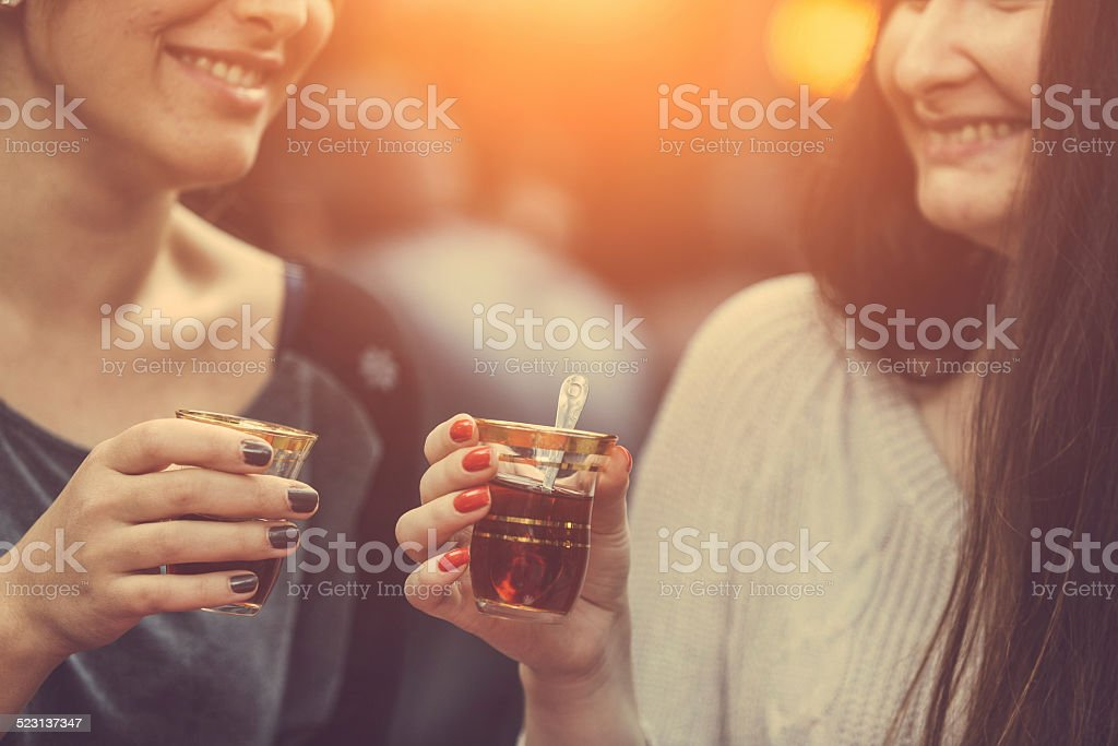 Two Women Drinking Cay, Traditional Turkish Tea, in Istanbul stock photo