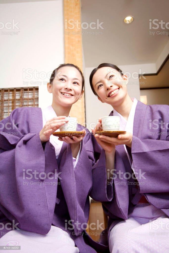 Two women drinking tea in a ryokan royalty-free stock photo
