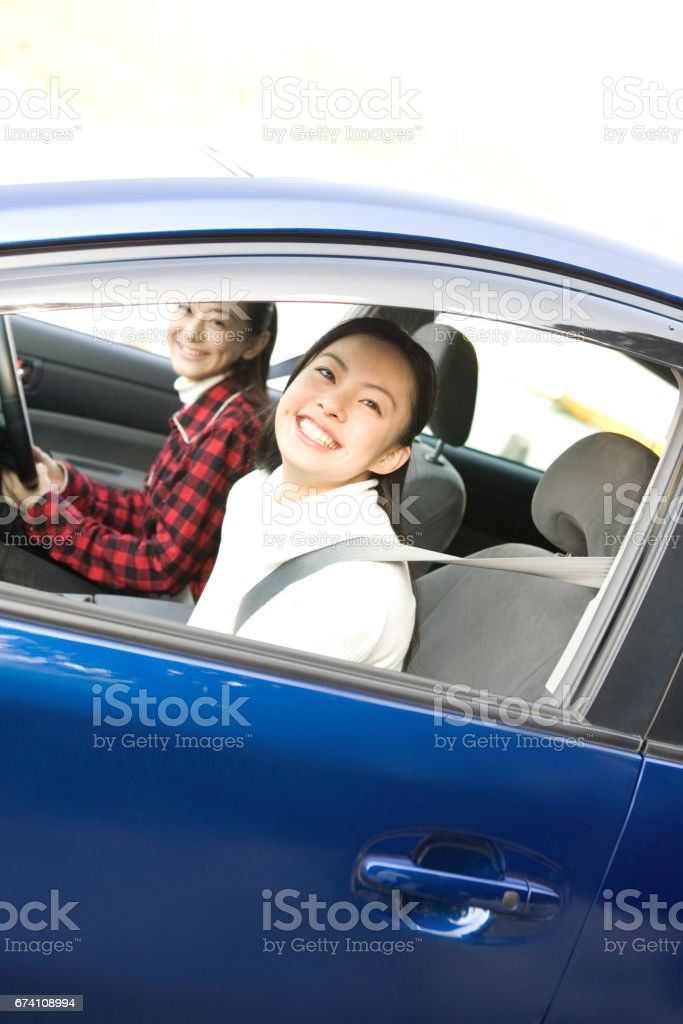 Two women drive royalty-free stock photo