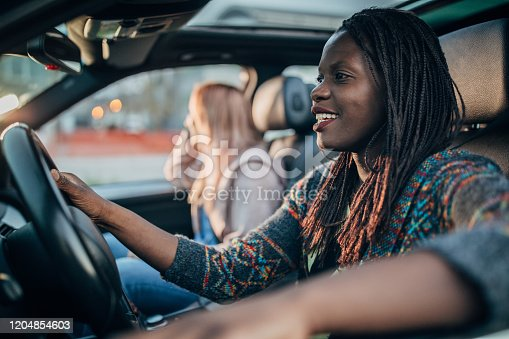 812419994 istock photo Two women driving in a car 1204854603