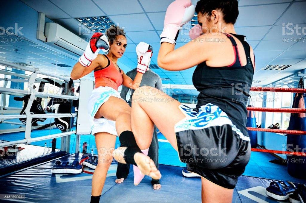 Two women during kickboxing practice stock photo