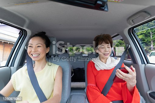 972962180 istock photo Two women enjoy driving 1250975062