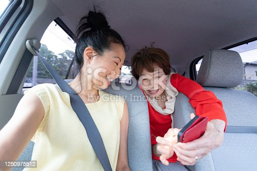 972962180 istock photo Two women enjoy driving 1250975512