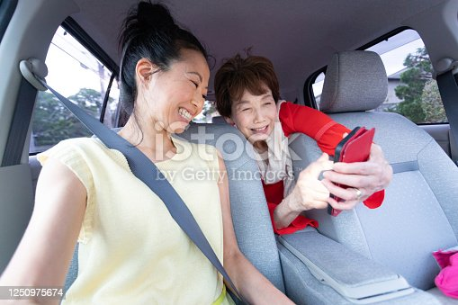 972962180 istock photo Two women enjoy driving 1250975674
