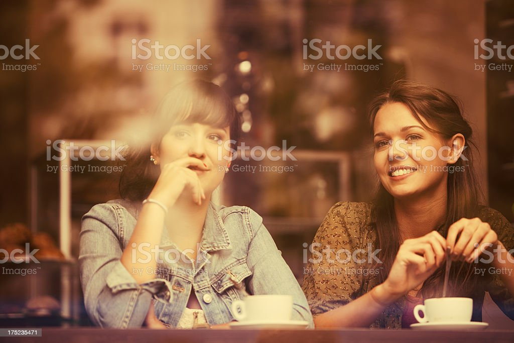 Two women enjoying cups of coffee stock photo