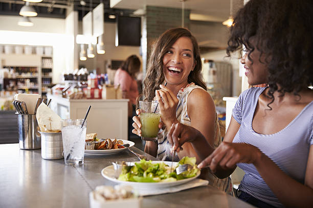 Two Women Enjoying Lunch Date In Delicatessen Restaurant - Photo