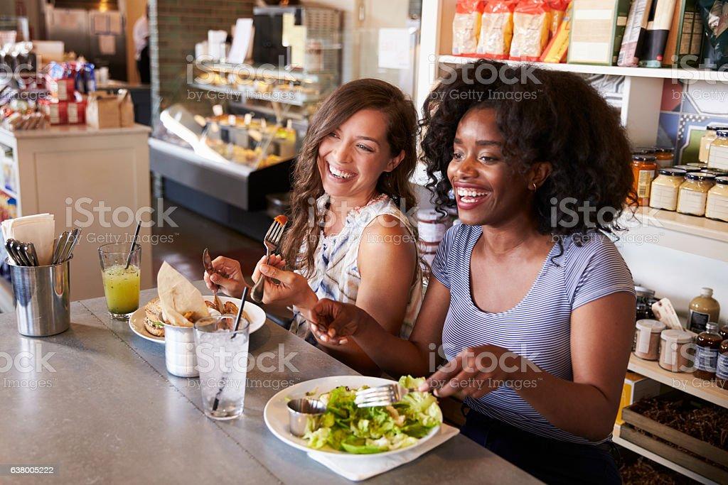 Two Women Enjoying Lunch Date In Delicatessen Restaurant - Photo