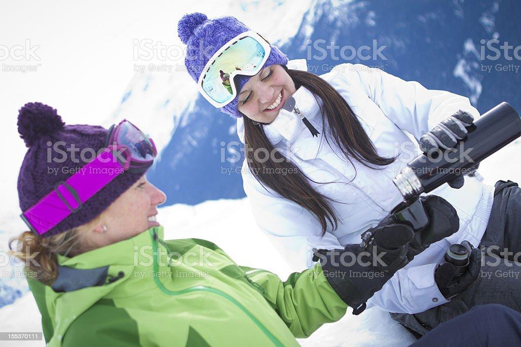 Two women enjoying tea in mountains. royalty-free stock photo