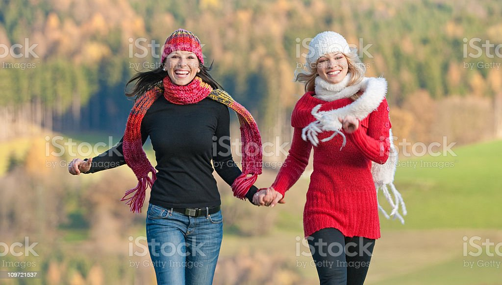 Two Women enjoying this beautiful Fall Day (XXXL) royalty-free stock photo