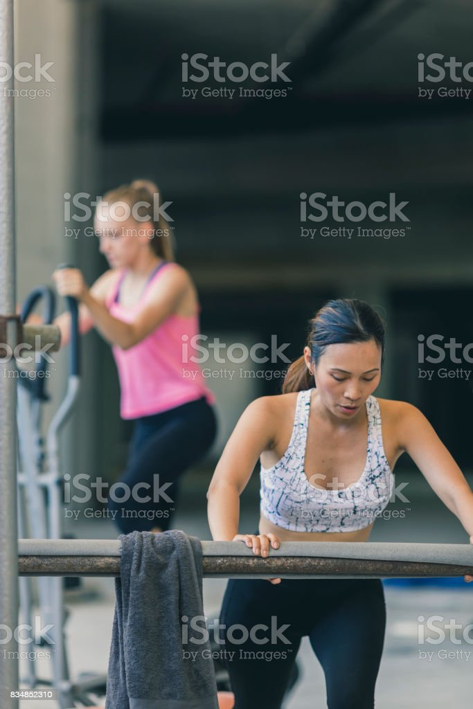 Two women exercising in an urban gym stock photo & more pictures of
