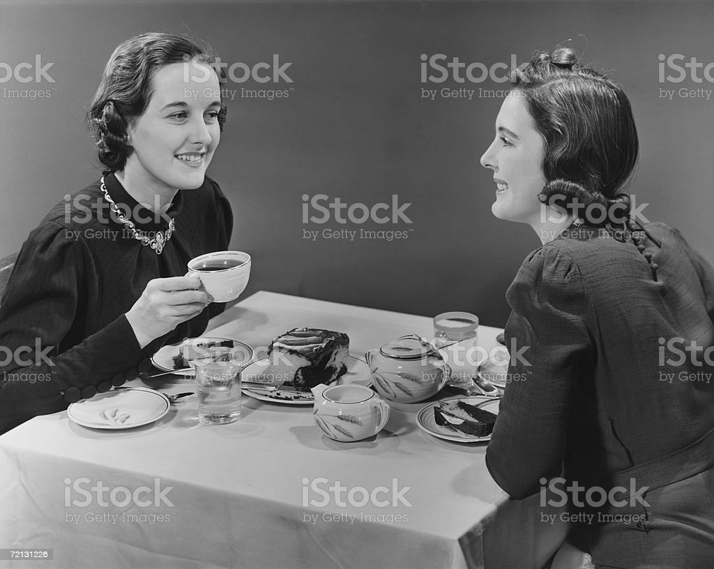 Two women having coffee and cake (B&W) stock photo