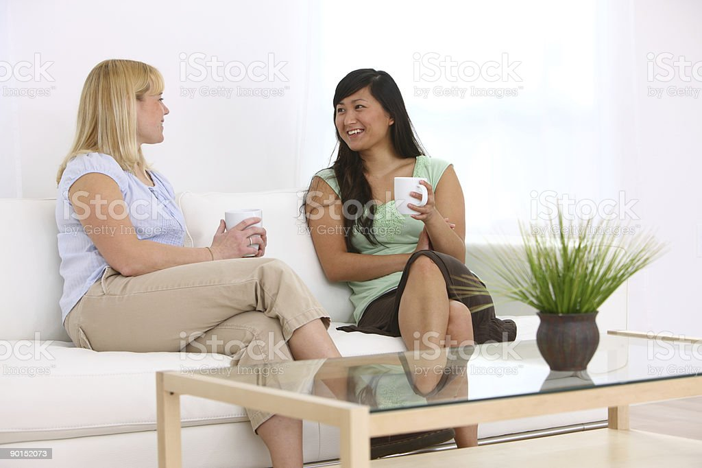 Two women having coffee together royalty-free stock photo